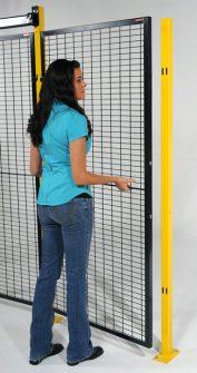 RapidGuard lifting machine guard panel into place