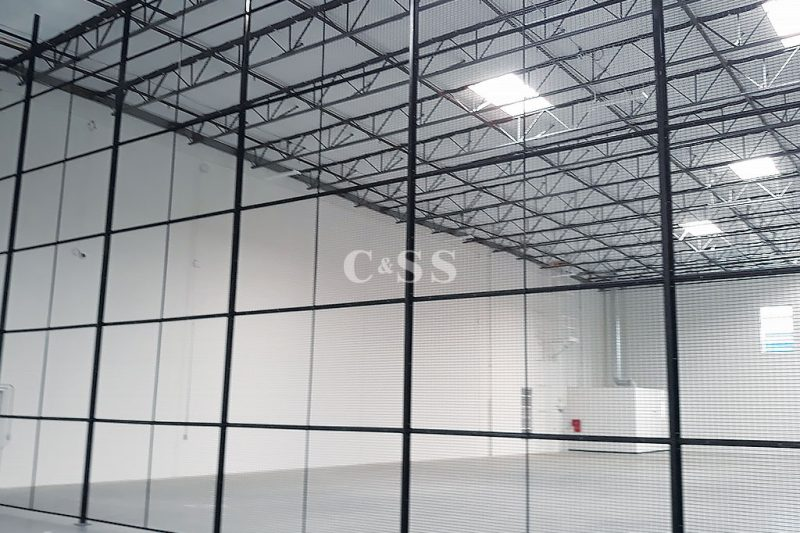 Steel Mesh Storage Cages Installed in Tech Warehouse
